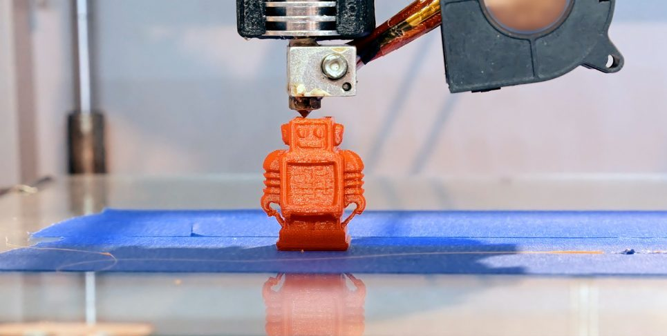 Automatic three dimensional 3d printer performs product creation. Modern 3D printing or additive manufacturing and robotic automation technology. Photo via istockphoto