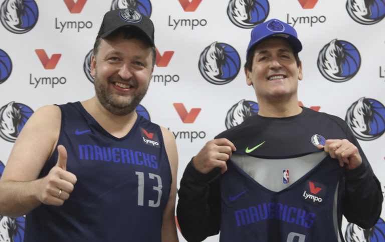 Introducing Crypto Fitness Gamification: Dallas Mavericks owner Mark Cuban and Tony G. from Lympo celebrate the U.S launch of Lympo, the nation's first blockchain fitness app, in partnership with the Dallas Mavericks, at the Dallas Mavericks' Lympo Practice Facility in Dallas, Texas on Friday, Nov. 16. [Photo: Peter Larsen]