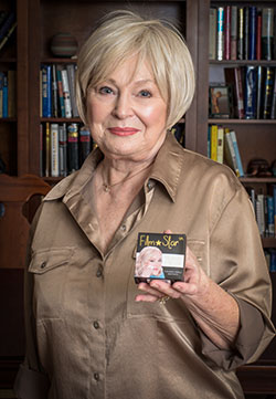 Barbara Russell Pitts holds another of the sisters' inventions, Film Star reusable makeup applicators. Photo by Michael Samples.