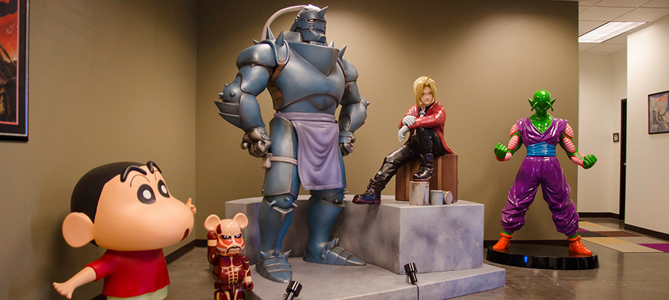 Large action figures great guests in the lobby of the Funimation office in Frisco. [Photo: Hannah Ridings]