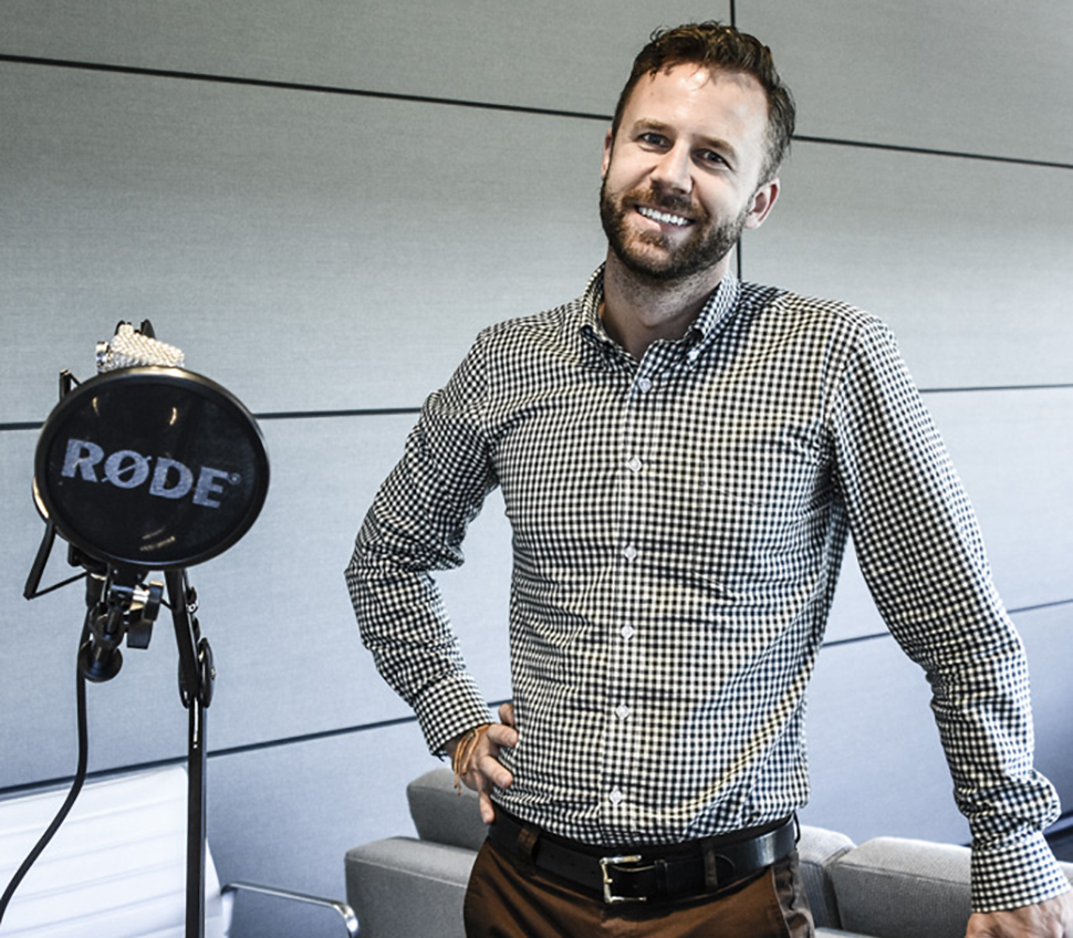 Sabre journalist, Nick Vivion, shows off the new podcasting studio in the C-Suite. The mobile equipment allows the team the flexibility to cover stories offsite. Vivion covers trends and stories relevant to the travel industry for Sabre.