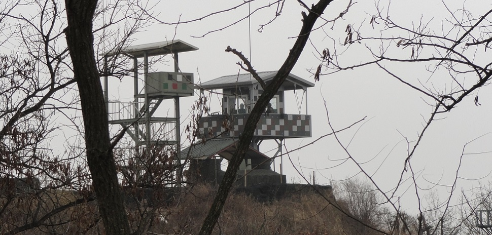 The DMZ (demilitarized zone) along the 38th parallel between North and South Korea, was created by agreement between North Korea, China, and the United Nations in 1953 and is guarded continuously.