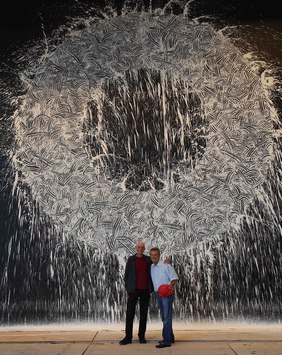 "Craig Hall, right, with British artist Richard Long, who created ""Dallas Rag"" in the lobby of KPMG Plaza. in the Arts District. [Photo Courtesy of Hall Group]"