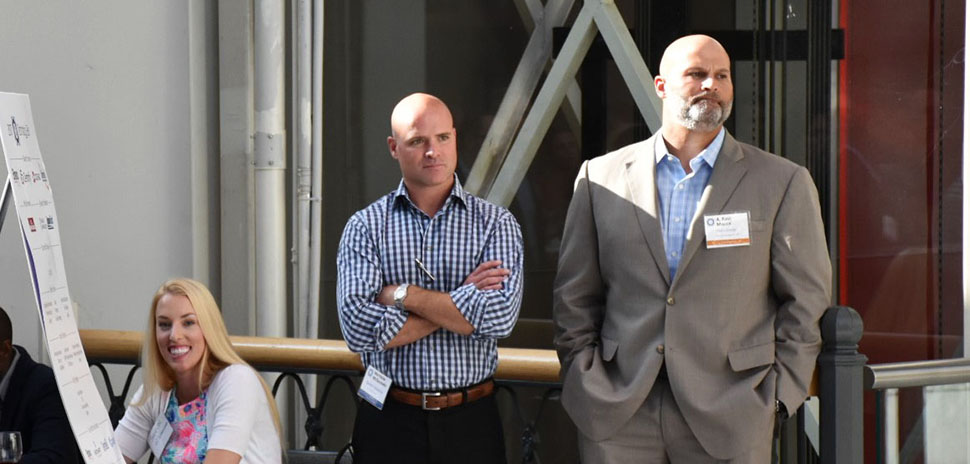 Shannon Helms, r2 Technologies Technical Recruiter at check in, along with Matt McGaughey, Spinakr Solutions Founder & CEO and A. Ravi Malick, Vistra Energy SVP Technology & CIO listen to the evening's program