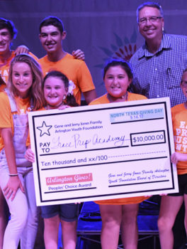Grace Prep Academy hold check at 2017 North Texas Giving Day