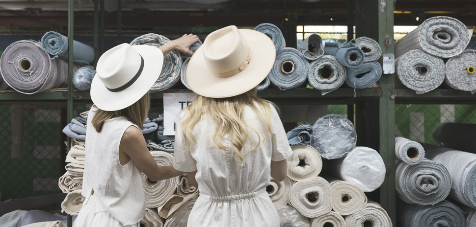 Founder Carly Burson and Katie Samson at a textile factory in Guatemala. [Photo courtesy of Tribe Alive]