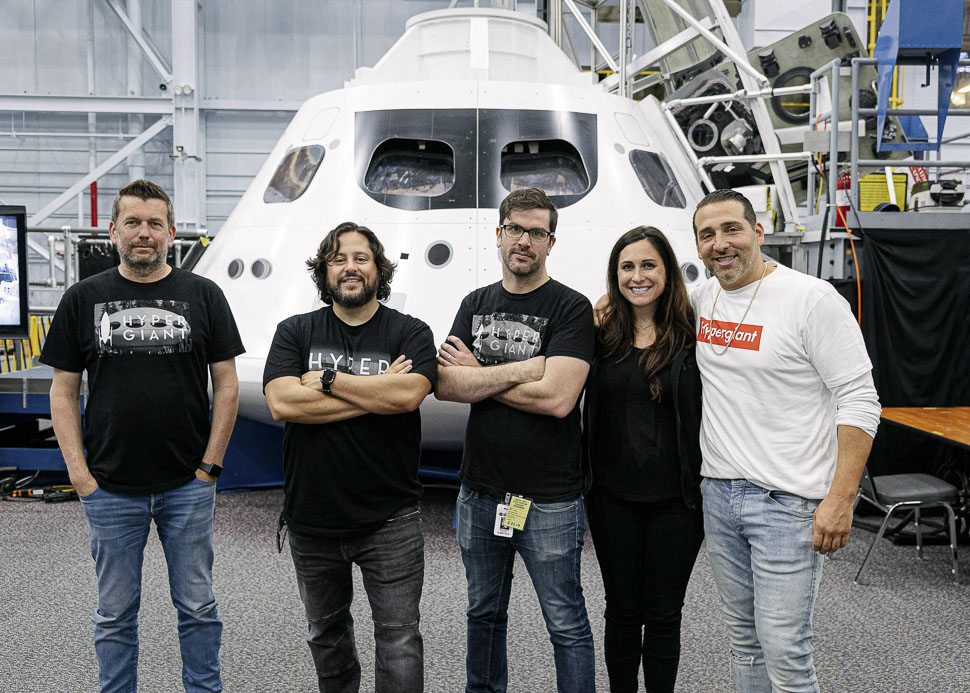 Hypergiant CEO Ben Lamm (second from left) with members of the team. [Photo: Courtesy of Hypergiant]
