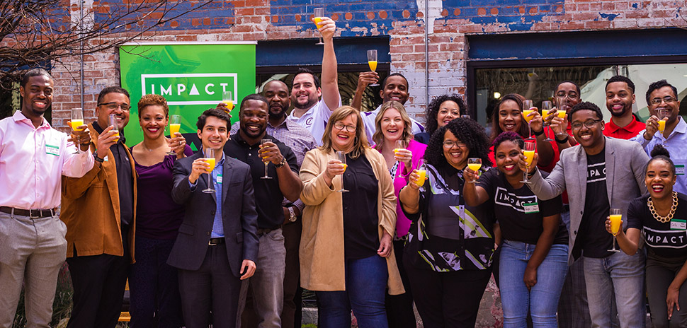 Entrepreneurs celebrate a 2019 Impact Ventures' cohort, photographed in the time before COVID. [Photo: Impact Ventures]